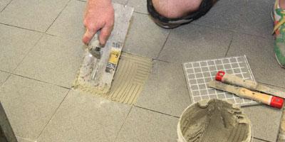 Regrouting of tile floor