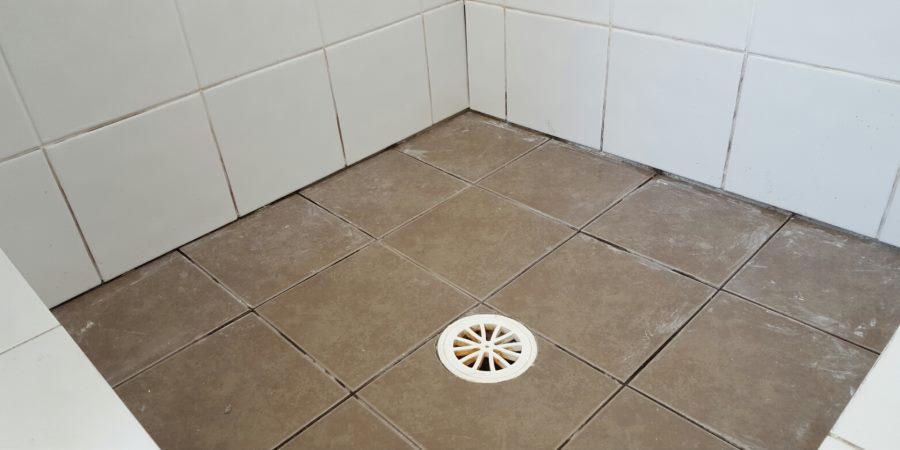 shower-drain-tiles-before